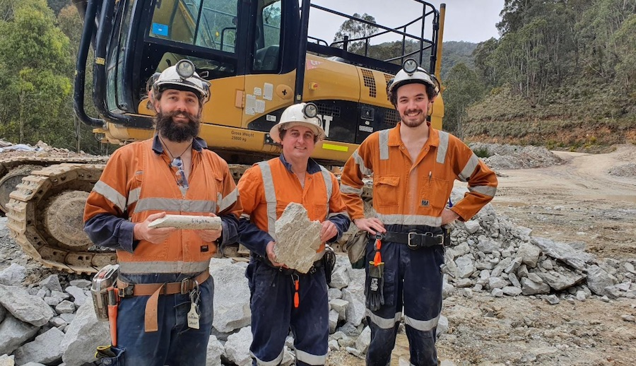 Geologists displaying first mined ore from the Queens Lode at the A1 Gold Mine